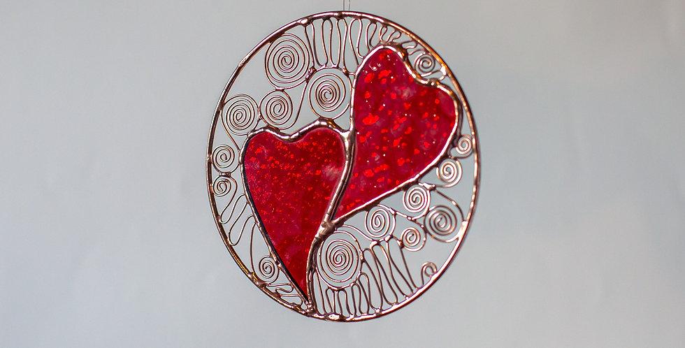 Interlocking Red Hearts in Brass Ring