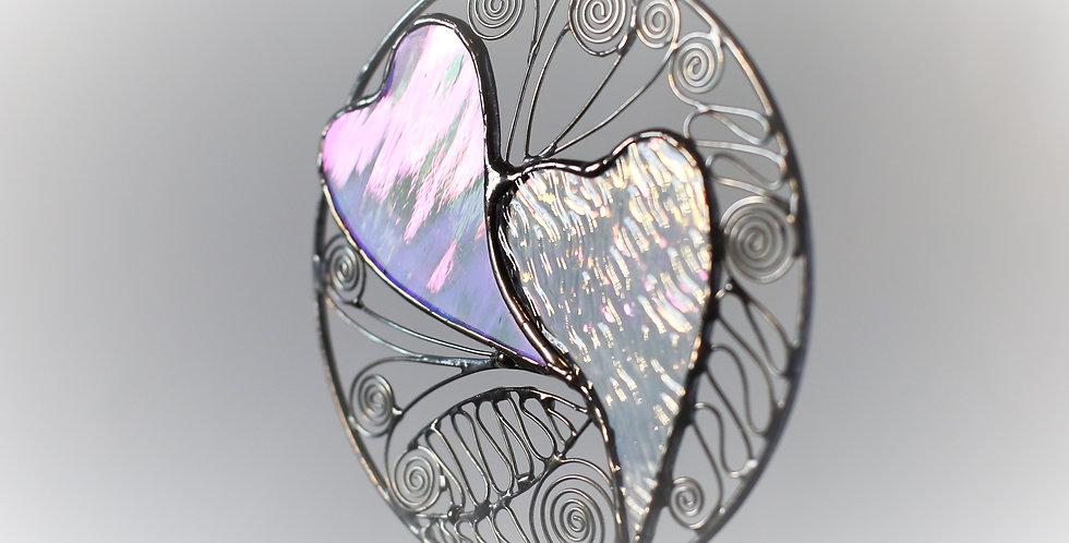 Interlocking Irridescent Hearts in Brass Ring