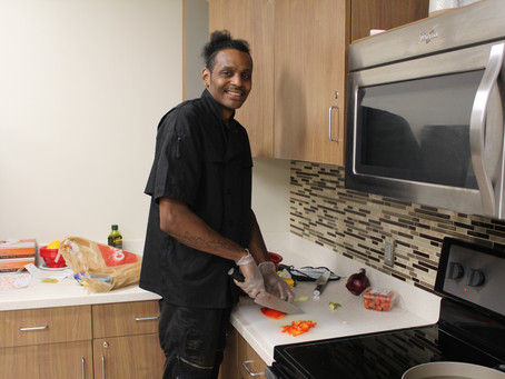 Volunteer Chef Chris Cooks in ACE's Kitchen
