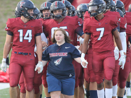 Tompkins HS Football Team Escorted on Field by Biggest Fan