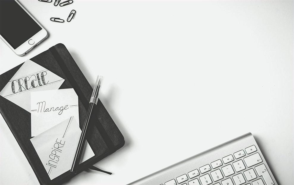 black-pen-near-iphone-and-apple-magic-ke