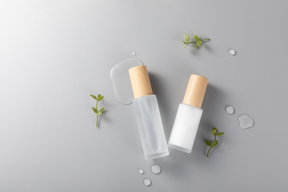 top-view-skincare-bottles-surface-with-green-plants-2.jpg