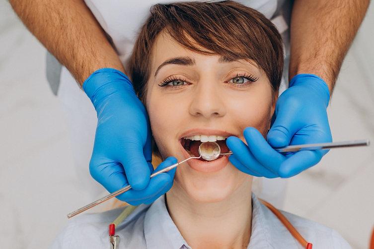 female-patient-sitting-dentist-chair-mak