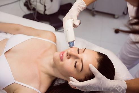 dermatologist-giving-facial-massage-thro