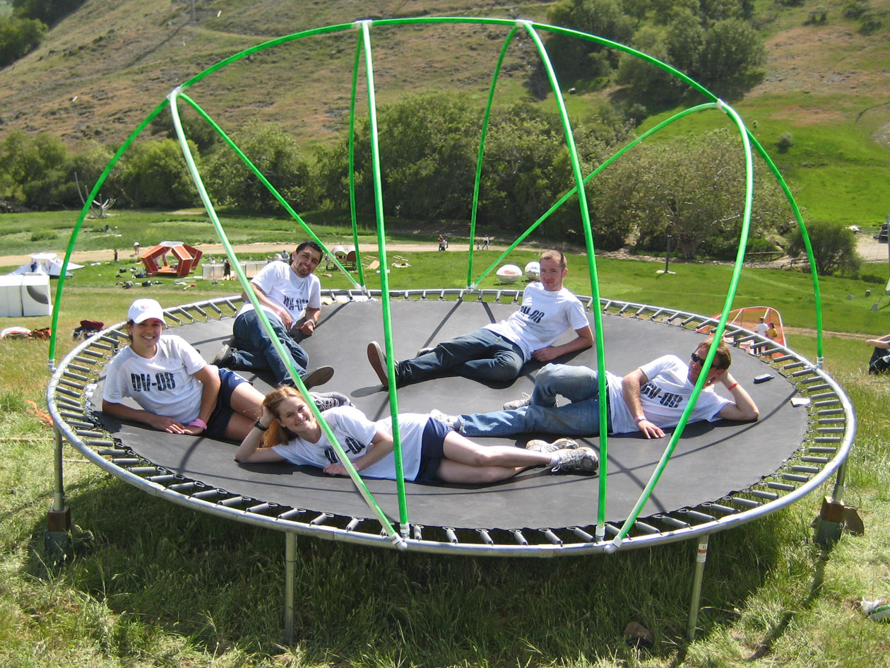 group laying on tramp during construction