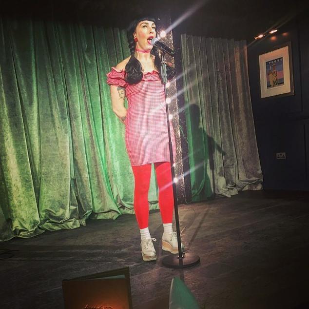 Lala Barlow singing at Freedom Bar Soho in London as part of Kinky Kabaret.