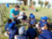 A volunteer teaching a primary school class in the local community.