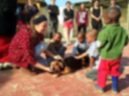 A volunteer education children about animal welfare in the township.