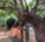 Horseriding safari Africa girl kissing horse