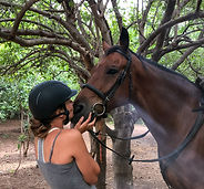 Horseriding safari Africa girl kissing horse