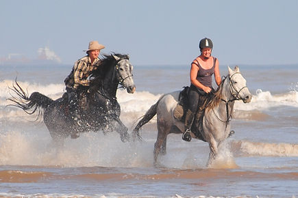 Riders Galloping their Horses through the Sea.
