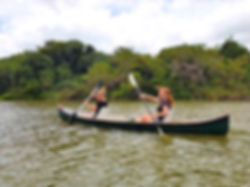 Two girls canoeing on a river