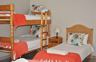 Kei Mouth Guest Lodge bedroom with bunkbeds.