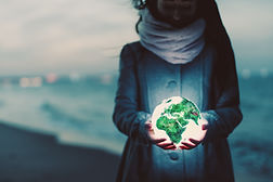 earth-globe-glowing-in-womans-hands-on-the-beach-a-TJ2ABV3.jpg