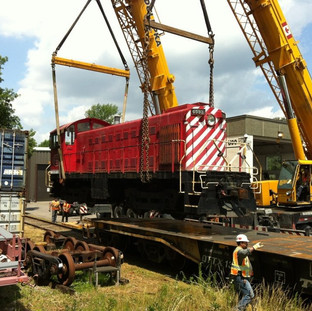 Craning Locomotive Onto Flatbed Railcar