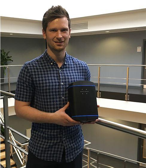 Sam Brocksopp holding the Zephyr® air quality sensor