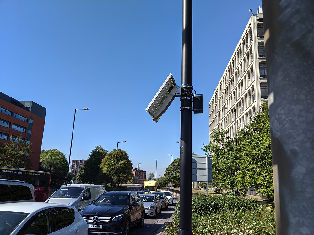 Zephyr air quality sensor on a lamp post near traffic on the ring road in wolverhampton