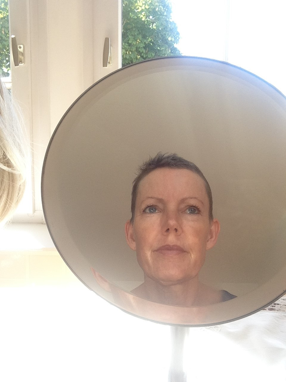 Cancer patient looking in the mirror