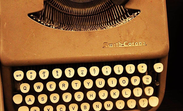 Photo of an antique Smith-Corona typewriter. Content marketing includes copywriting, photos, videos, and puting the right words and visual elements together.