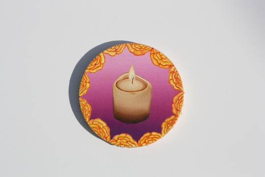 Candle and Marigolds