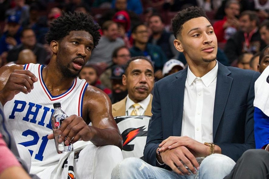 Joel Embiid (Left) Ben Simmons(Right) presumably thinking about how they could have two first round selections {AP PHOTO/CHRIS SZAGOLA}