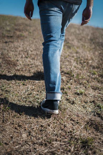 Revtown jeans on walking male model