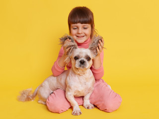 girl-with-dog-playing-together-lifts-ear