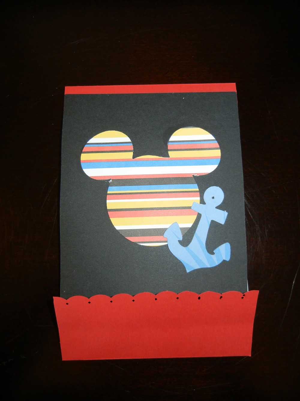Cover of the notepad -- Mickey's head and anchor to sail away!