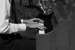 Running His Finger On The Piano