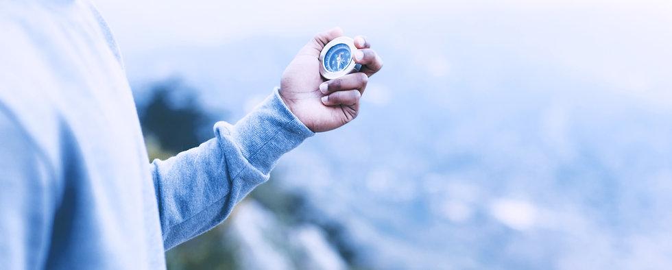 hiker-looking-compass_edited.jpg