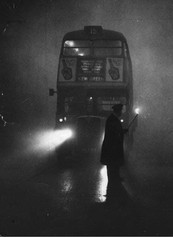 1950s London - Policeman guiding a bus with his flare