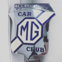 NOS Grille Badge