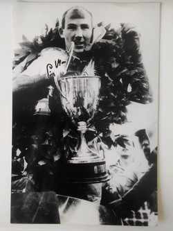 Stirling Moss and Trophies Signed