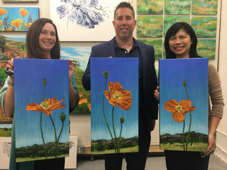 """Lucy Liew with clients holding original artwork """"Resilience Bouverie"""""""