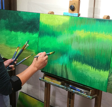 California artist Lucy Liew painting background in studio.jpg