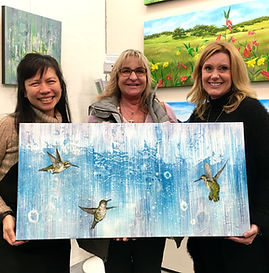 Artist Lucy Liew holding painting Lets Dance with clients.jpg