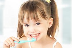 dental hygiene. happy little girl brushi