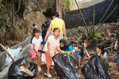 kids clean near new wall.JPG