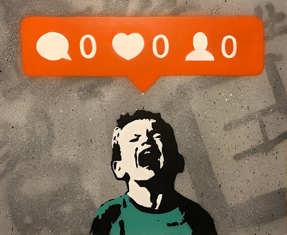 Graffiti art by artist iHart showing a young boy crying for not getting any social media reactions
