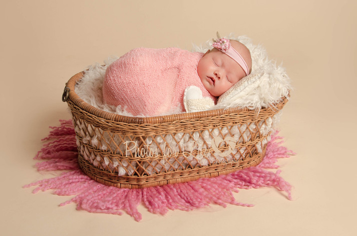 Newborn in basket oyster background Glasgow