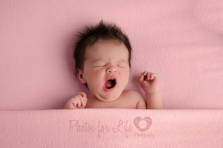 Yawning newborn pink, Glasgow
