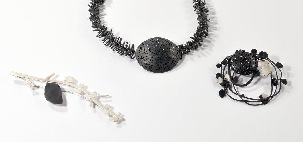 Neckpiece and brooches