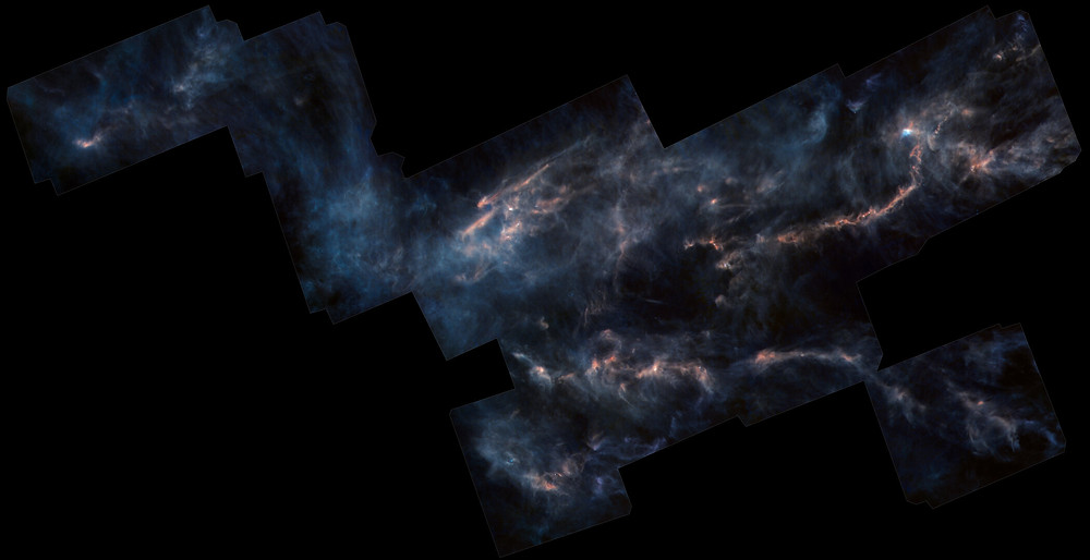 Taurus molecular cloud, glowing due to star formation within the cloud