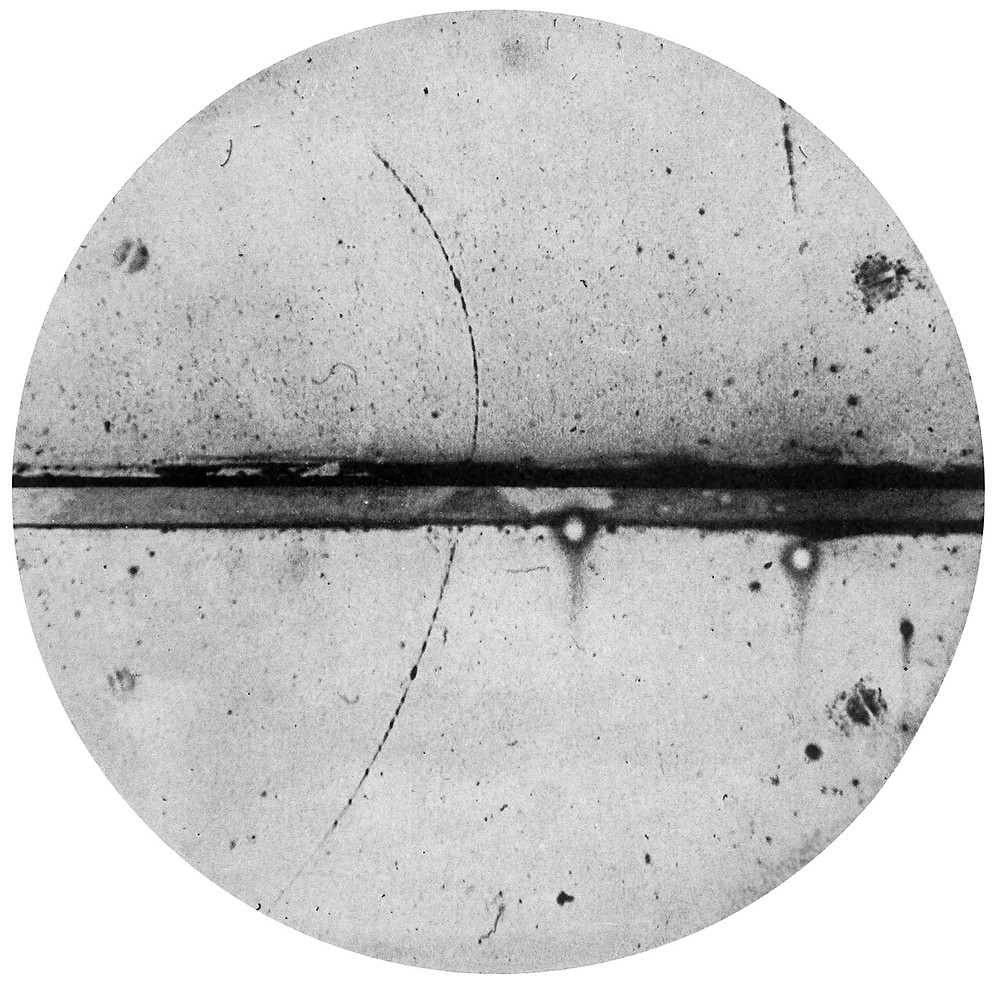 First cloud chamber photo of a positron's path