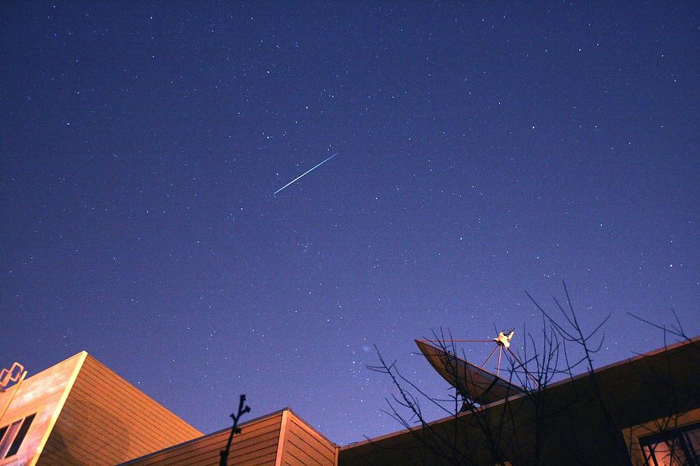 Comet Holmes and Iridium Flare