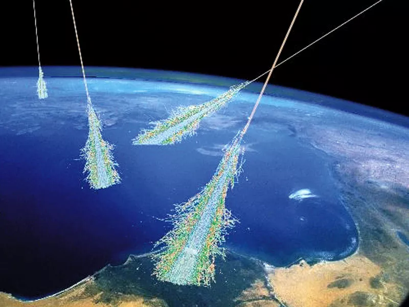 Artist conception of showers of cosmic rays passing through Earth's atmosphere