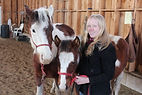 Sarah with her two horses - Sheye (left) and her filly Faith (middle)