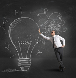 1200-165479307-light-bulb-with-businessman