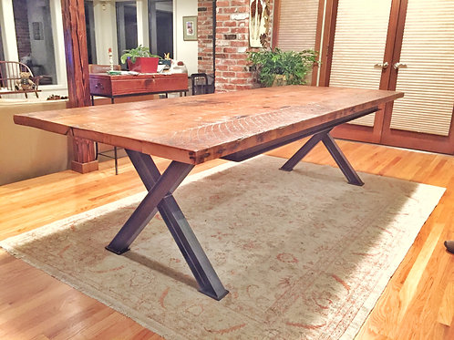 Dining table with reclaimed wood top and ibeam steel base.