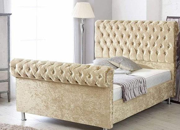 Sleigh top upholstered bed / chrome leg / beading